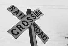 Free Grayscale Photography Of Railroad Crossing Signage Royalty Free Stock Images - 115423669