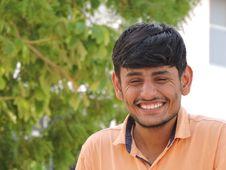 Free Man Smiles While Taking Photo Near Tall Tree At Daytime Stock Photo - 115423690