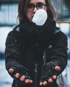 Free Woman Wearing Black Jacket Holding White Snow Stock Photography - 115423702