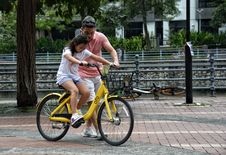Free Photography Of Girl Riding Bike Beside Man Stock Photo - 115483510