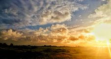 Free Green Grass Field Under Cloudy Sky During Sunset Royalty Free Stock Photo - 115483685