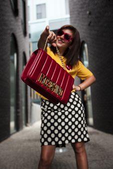 Free Woman Wearing Yellow Crew-neck T-shirt While Holding Red Handbag Royalty Free Stock Image - 115483706