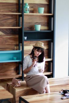 Free Photo Of Woman Sitting On Wooden Chair Stock Images - 115550134