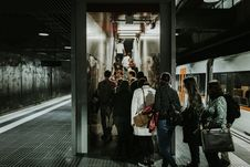Free Grayscale Photography Of People Falling In Line At Train Station Royalty Free Stock Photography - 115550277