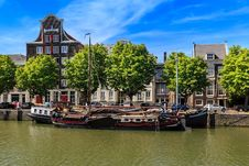 Free Sailboat On Dock Near Brown And Red Buildings Royalty Free Stock Photos - 115550328