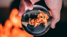 Free Person Holding Clear Glass Ball With Flame Stock Images - 115550344