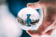 Free Person Holding Sphere Reflecting Dna-shaped Statue Stock Images - 115550354