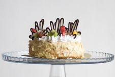 Free Photo Of Brown And White Icing Covered Cake With Kiwi Stock Photo - 115628190