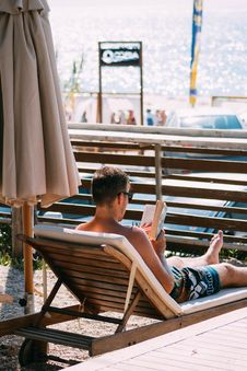 Free Photo Of Man Reading A Book Stock Photo - 115628210