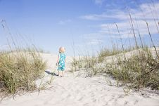 Free Toddler Wearing Blue Shirt Standing On White Sand Near Green Grass Photo Royalty Free Stock Images - 115628239