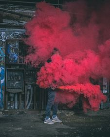 Free Photo Of Man Surrounded By Red Smoke Royalty Free Stock Photography - 115628277