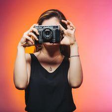 Free Woman Wearing Black Sleeveless Top Holding Gray Camera Stock Image - 115628311