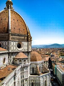 Free Brown And White Painted Cathedral Roof Overlooking City And Mountain Under Blue Sky Royalty Free Stock Images - 115628409