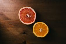 Free Two Sliced Citrus Fruits Stock Image - 115628451