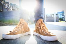 Free Person Wearing Brown-and-white High-top Sneakers Stock Images - 115694004