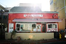 Free Red And White Pizzeria Cafe At Daytime Royalty Free Stock Photography - 115694047