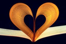 Free Two Lighted Pages Of Book Formed Into Heart Shape Inside A Dark Room Royalty Free Stock Photo - 115694075