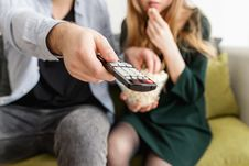Free Man Holding Remote Control Stock Photography - 115694192