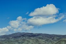 Free Mountains Under Blue Sky And Clouds Stock Image - 115773631