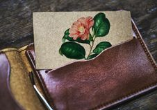 Free Brown Leather Card Wallet With Pink Petaled Flower Printed Card Royalty Free Stock Photography - 115773747
