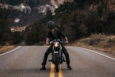 Free Man Riding Boxer Motorcycle On Road Stock Photo - 115773760
