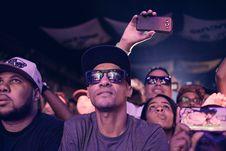 Free Man Wearing Black Sunglasses Sitting Next To Man Royalty Free Stock Photo - 115773775