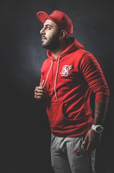 Free Man Wearing Red Pullover Hoodie And Gray Pants Royalty Free Stock Photography - 115773927