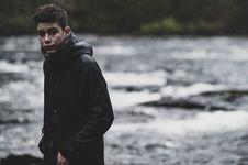 Free Man Wearing Black Rain Coat Royalty Free Stock Image - 115773996