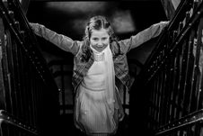 Free Grayscale Photo Of Girl Standing On Stairs Holding Hand Rails Royalty Free Stock Image - 115774016