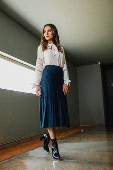 Free Woman Wearing White Long-sleeved Shirt And Blue Skirt Stock Image - 115844081