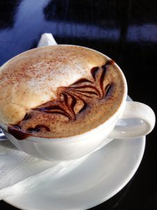 Free Cappuccino On White Ceramic Cup With Saucer Stock Photos - 115844133