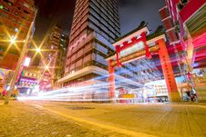Free Time Lapse Photography Of Vehicles Passing Through China Town Stock Photography - 115844142