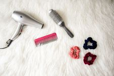 Free Grey Hair Blower Near Pink Hair Combs And Scrunchies Stock Photography - 115844232