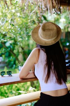 Free Woman Wearing White Tank Top And Black Pants With Brown Sun Hat Royalty Free Stock Photo - 115844255