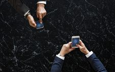 Free Two Person Holding White And Black Android Smartphones Stock Photography - 115844292