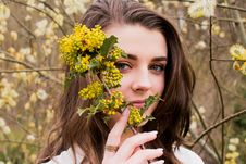 Free Woman Taking Photo With Holding Yellow Flower Buds At Daytime Royalty Free Stock Images - 115844309