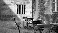 Free Grayscale Photo Of 4-piece Dining Set Near Concrete Building Stock Image - 115844331