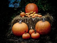 Halloween Pumpkins On A Hay Bale At Dusk Stock Photography