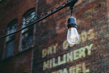 Free Turned On Black Lamp Near Brown Bricks Concrete Wall Stock Image - 115913601