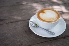Free White Ceramic Coffee Cup With White Ceramic Saucer Royalty Free Stock Photography - 115913637