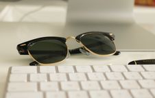 Free Black Ray-ban Clubmaster Sunglasses On White Surface Royalty Free Stock Photos - 115913648
