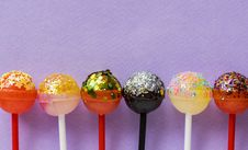 Free Six Assorted-color Lollipops Stock Image - 115913701