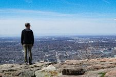 Free Man Wearing Black Jacket Standing On Rock Monolith Royalty Free Stock Photography - 115913767