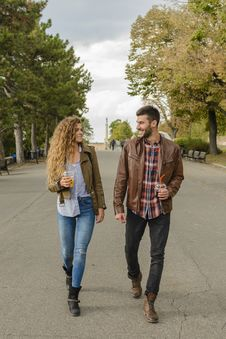Free Man And Woman Wearing Brown Coats Walking On Pavement Stock Images - 115913774