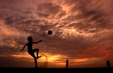 Free Silhouette Of A Boy Playing Ball During Sunset Royalty Free Stock Photography - 115913817