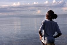 Free Woman Sitting By The Ocean Royalty Free Stock Photos - 115976838