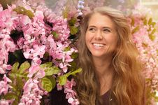 Free Photo Of Woman Standing Beside Pink Flowers Stock Images - 115976904
