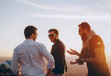 Free Three Men Standing While Laughing Royalty Free Stock Photo - 115976975