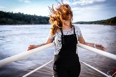 Free Woman Wearing Gray Shirt And Black Overalls On Boat Stock Images - 115977014