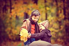 Free Two Boys Wearing Jacket Holding Yellow Maple Leaves Royalty Free Stock Photos - 115977028
